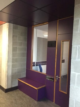 Purple formica doors and panelling